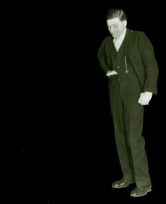 Man in suit looking down