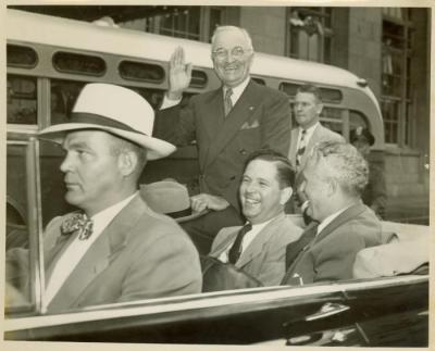 Photograph, President Harry S. Truman riding in an automobile while in Grand Rapids, Michigan for a campaign speech
