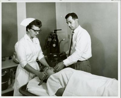 Photograph, Pine Rest Nurse performing Electro-Stimulus Therapy