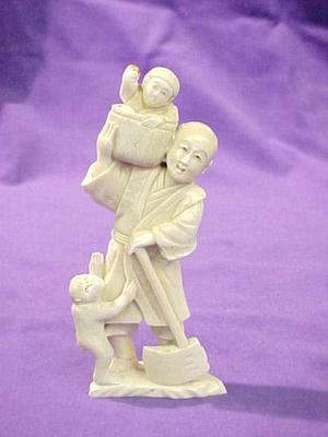 Figurine, Man With Ax Holding Child In Basket On Shoulder